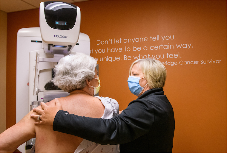 photo of woman getting mammogram
