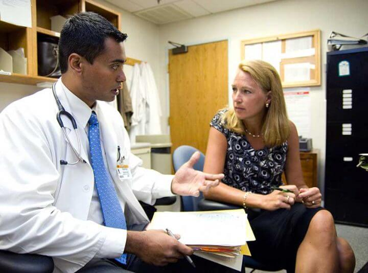 "Erika Ringdahl, MD, right, director of the MU Family Medicine Residency program and professor of family and community medicine at the MU School of Medicine, talks to resident physician Paresh Ghodge, MD, in 2007. Ringdahl is the lead investigator for a five-year project ""Aligning Residency Education with Clinical Practice Transformation."""