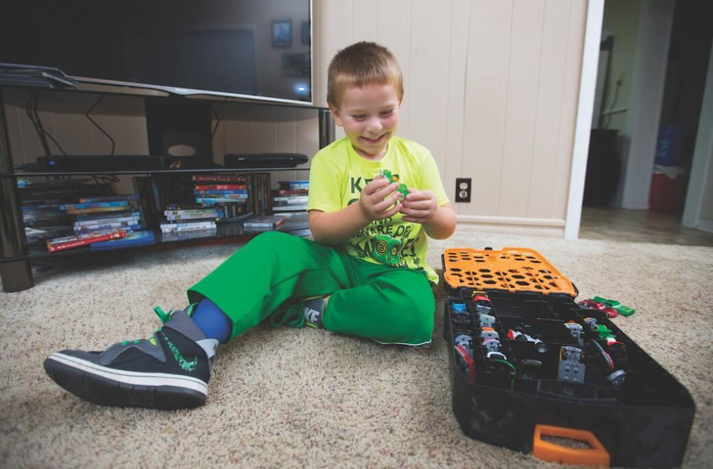 Photo of boy playing with toys