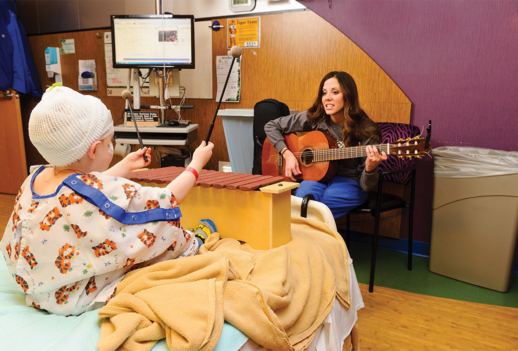 Photo of music therapist and child patient.