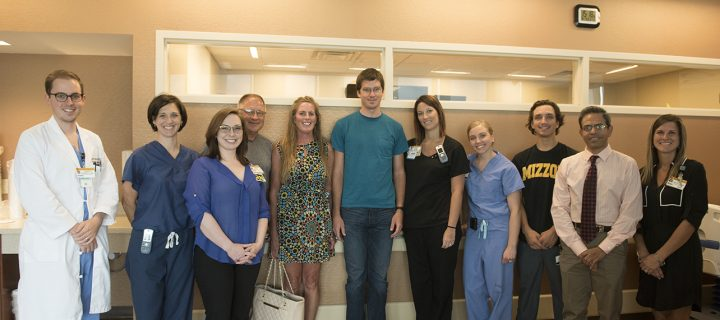 Casey O'Connor (center, teal shirt), his parents and care team.