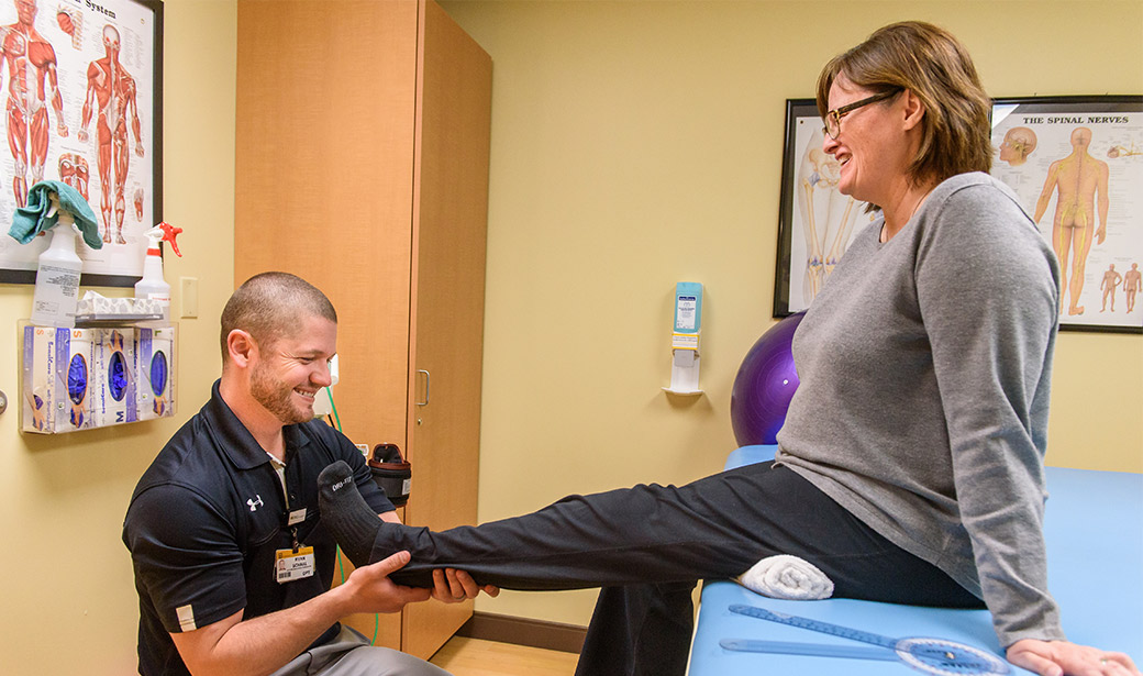 Photo of physical therapist Ryan Schaal with patient at Missouri Orthopaedic Institute.