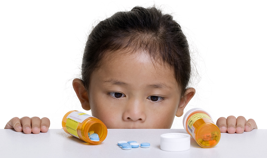 kid with pills