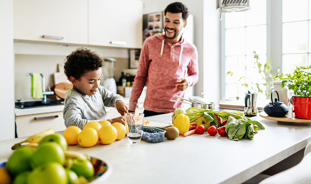 father and son cook healthy food