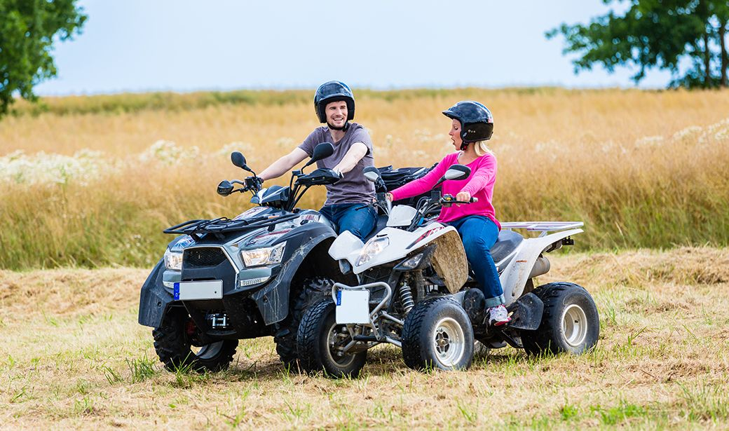 Couple riding ATV