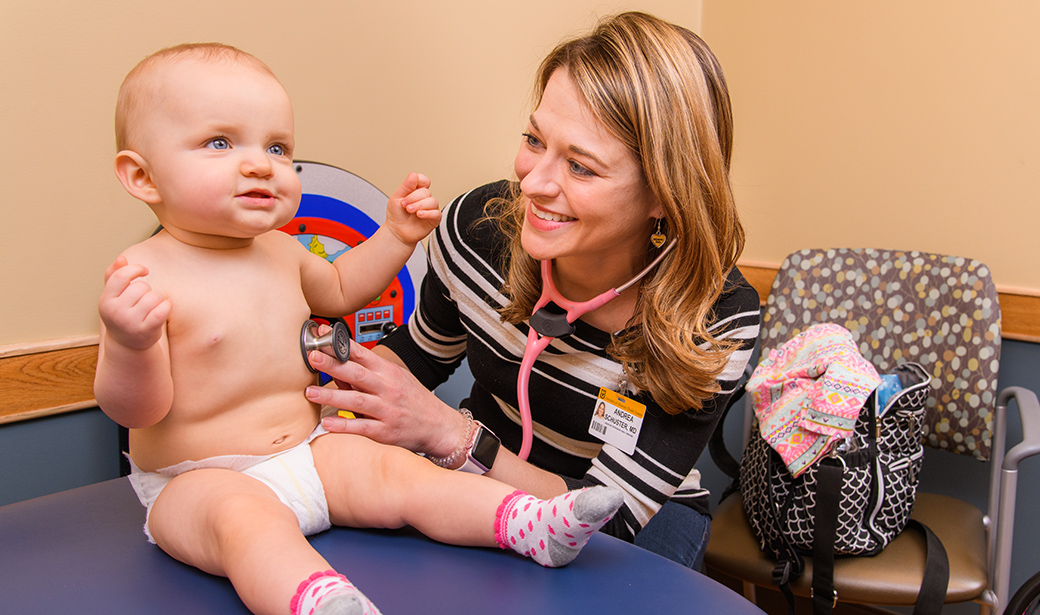Andrea Schuster, MD with infant patient