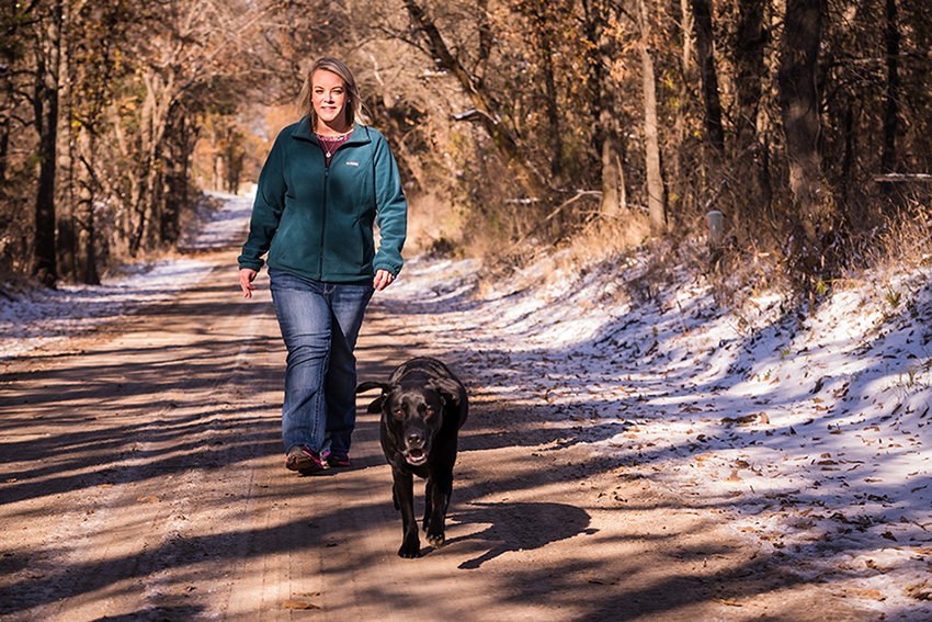 Megan Lawson walks with her dog after weight loss surgery