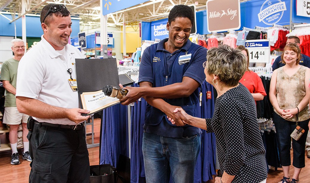 Joanne Witting, right, expresses her appreciation during a Community Hero recognition ceremony in June at the West Broadway Walmart in Columbia.