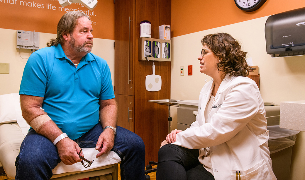 Mark Terry meets with MU Health Care urologist Katie Murray, DO