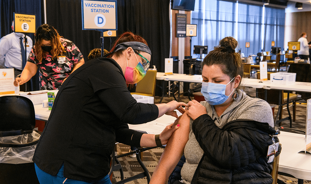 Photo of person getting the COVID-19 vaccine.