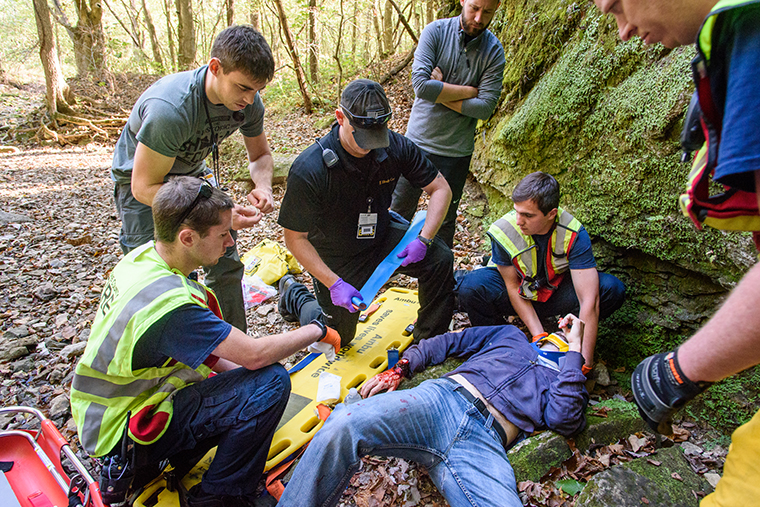 niversity of Missouri Health Care emergency medicine physicians and staff conducted outdoor training to simulate wilderness-related injury scenarios.