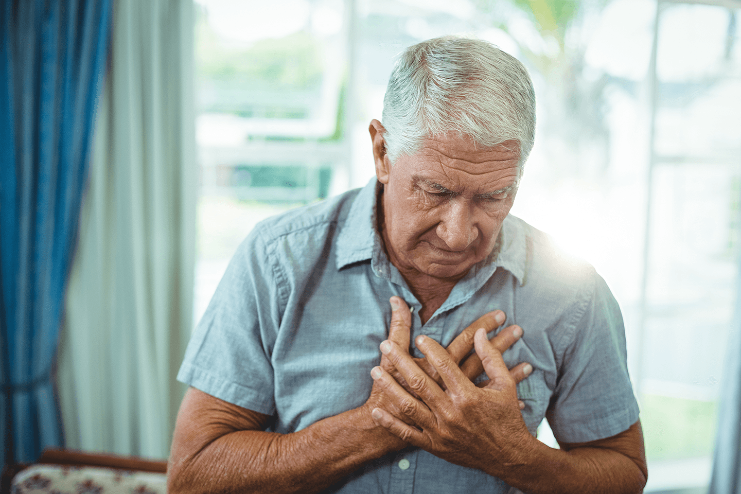 photo of man with chest pain