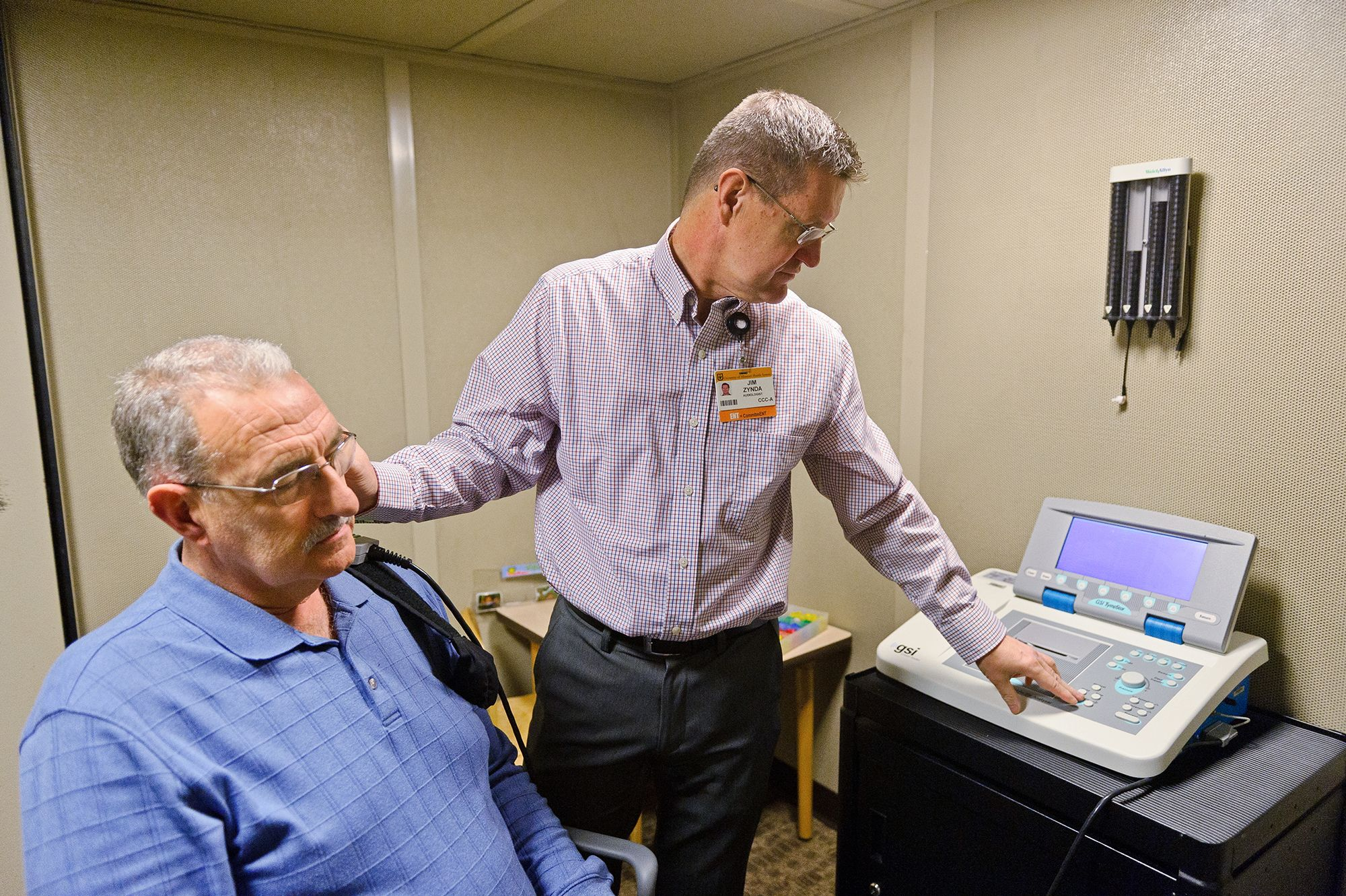 photo of man getting hearing loss test