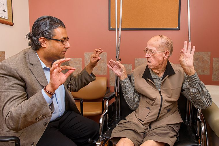 Photo of Dr G and movement disorders patient