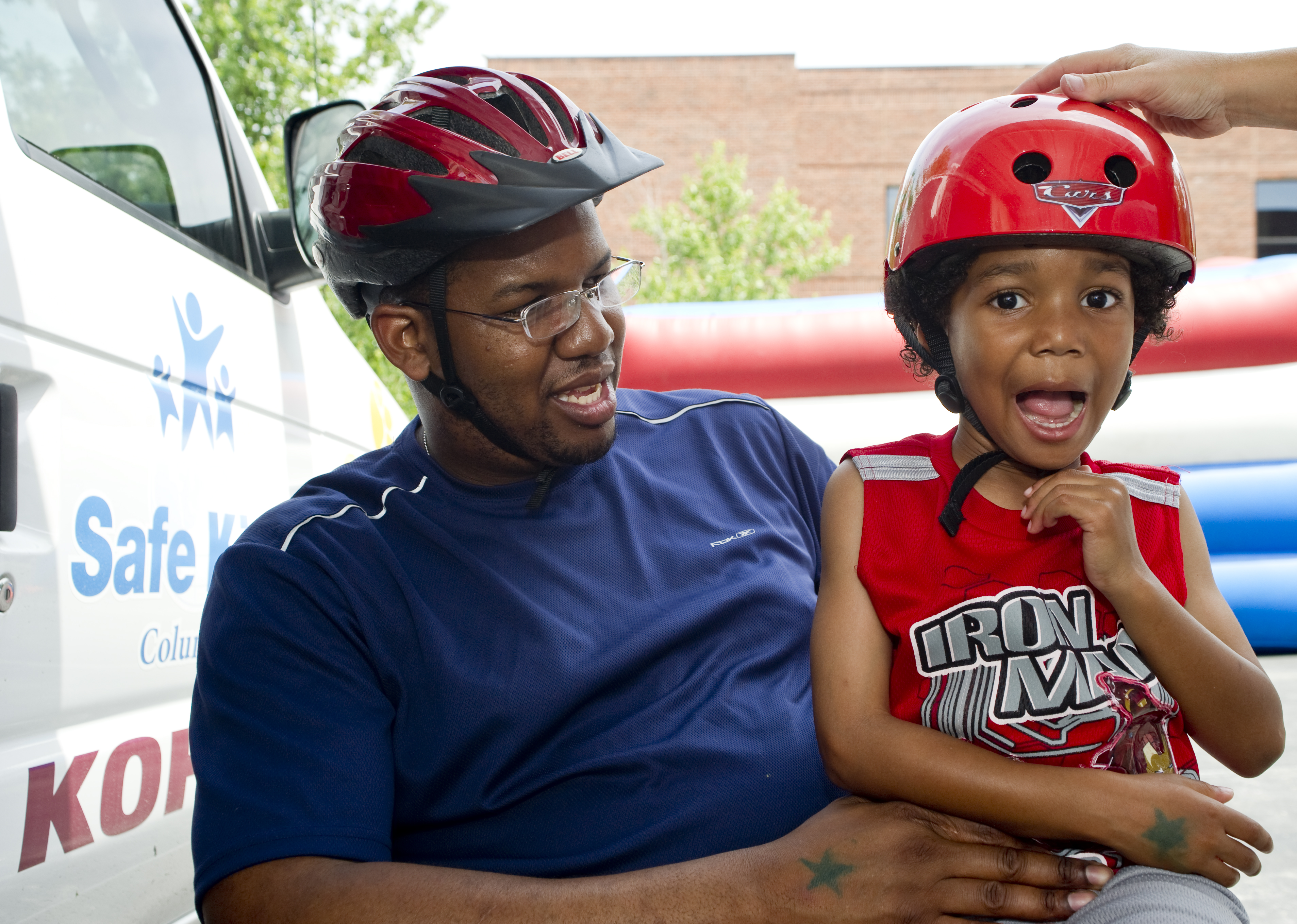 safe kids day parent and child with helmets