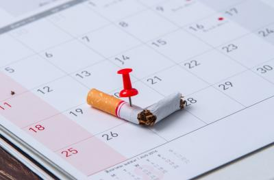 photo of broken cigarette on calendar