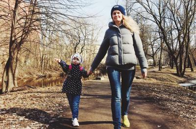 Mom, Daughter Walking in Winter