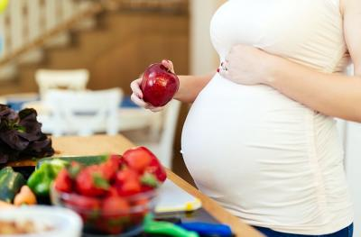 pregnant woman with fruit and vegetables