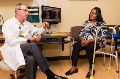 Vinita Taylor meets with spine surgeon Ted Choma, MD