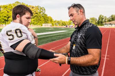 MU Health Care athletic trainer Rick Sage examines Zane Rice