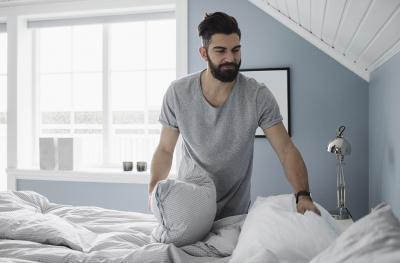 man making the bed