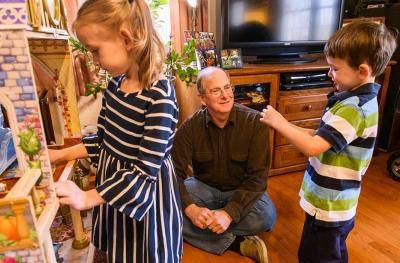 Paul Penn, thyroid cancer patient at Ellis Fischel, plays with his grandchildren.