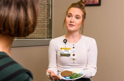 Dietitian Michelle Bauche meeting with bariatric surgery patient