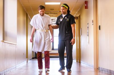 Eric Kelly, RN with patient