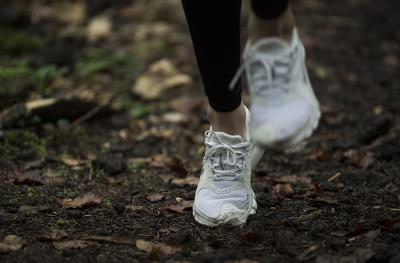 running shoes of a jogger on a trail