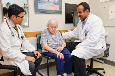 photo of doctors with patient