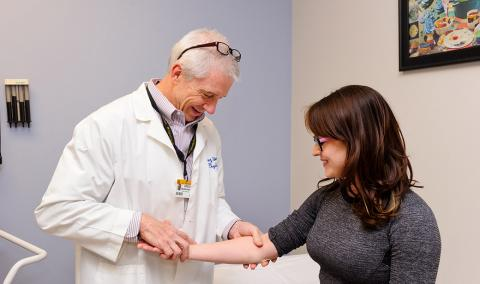 Dr. Greg Worsowicz interacts with a patient.