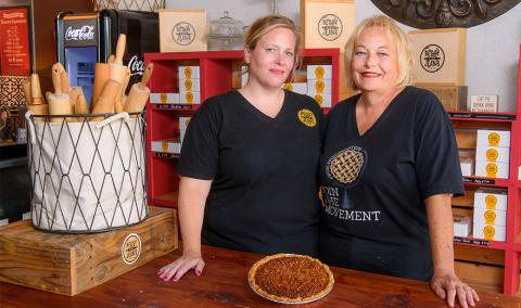 Photo of Rebecca Miller and Jeann Plumley baking pies.