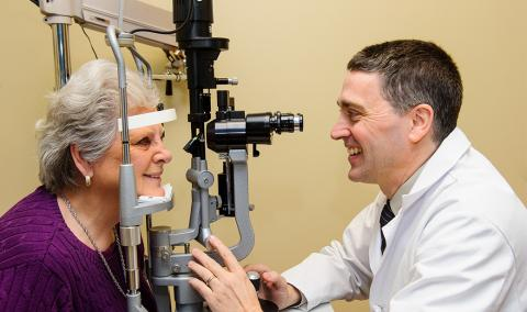 Frederick Fraunfelder, MD, MBA, performs an eye exam.