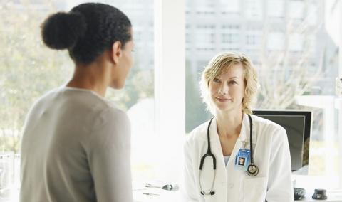 Woman and physician talking