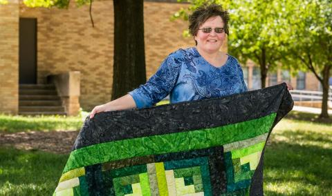 Brenda Duncan with quilt