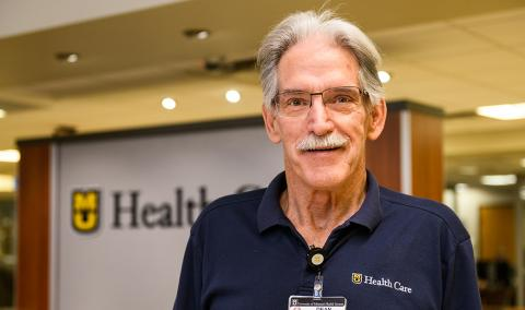 photo of Dean Bell volunteering at MU Health Care