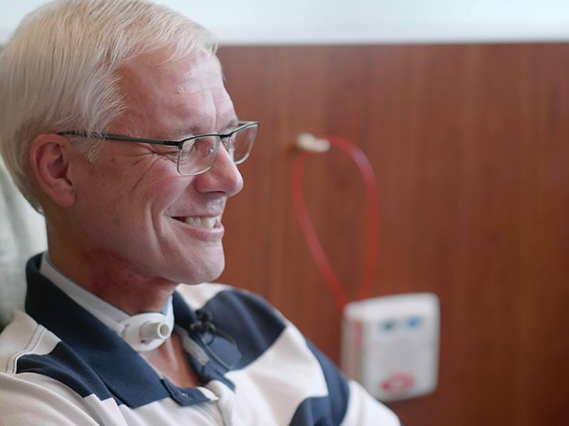 Tery Donelson smiles while receiving an infusion