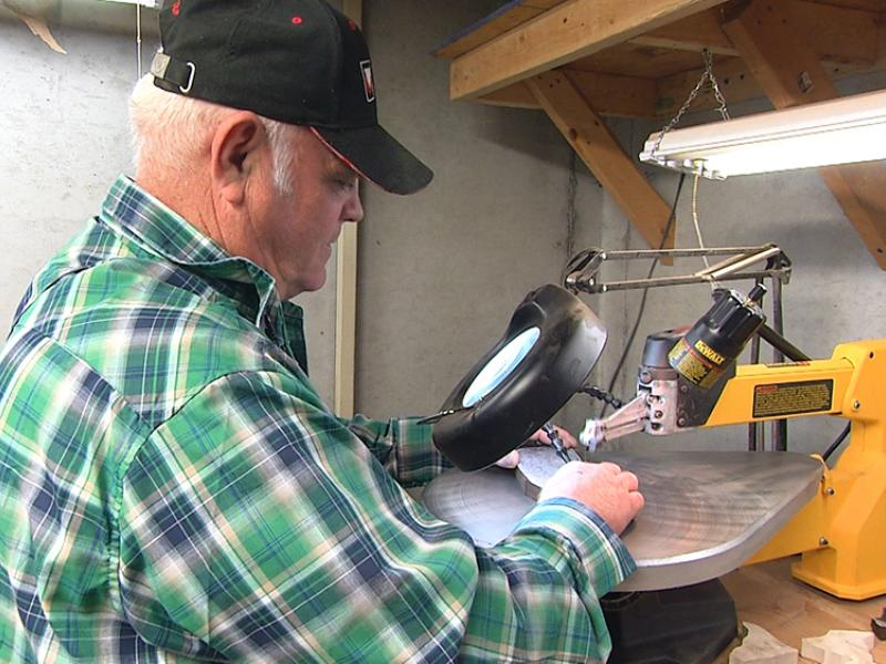 Rick Allain works at his saw