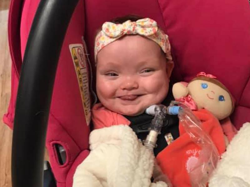 Joy Day smiles as she heads home from the hospital