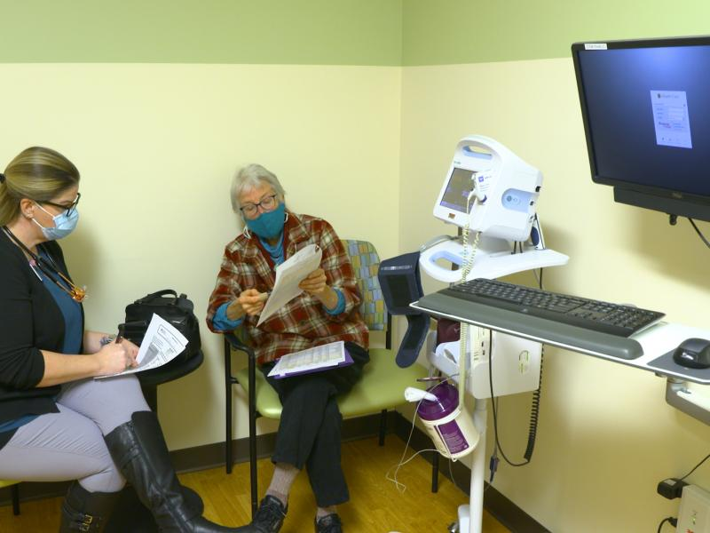Woman talks with nurse practitioner in doctor's office