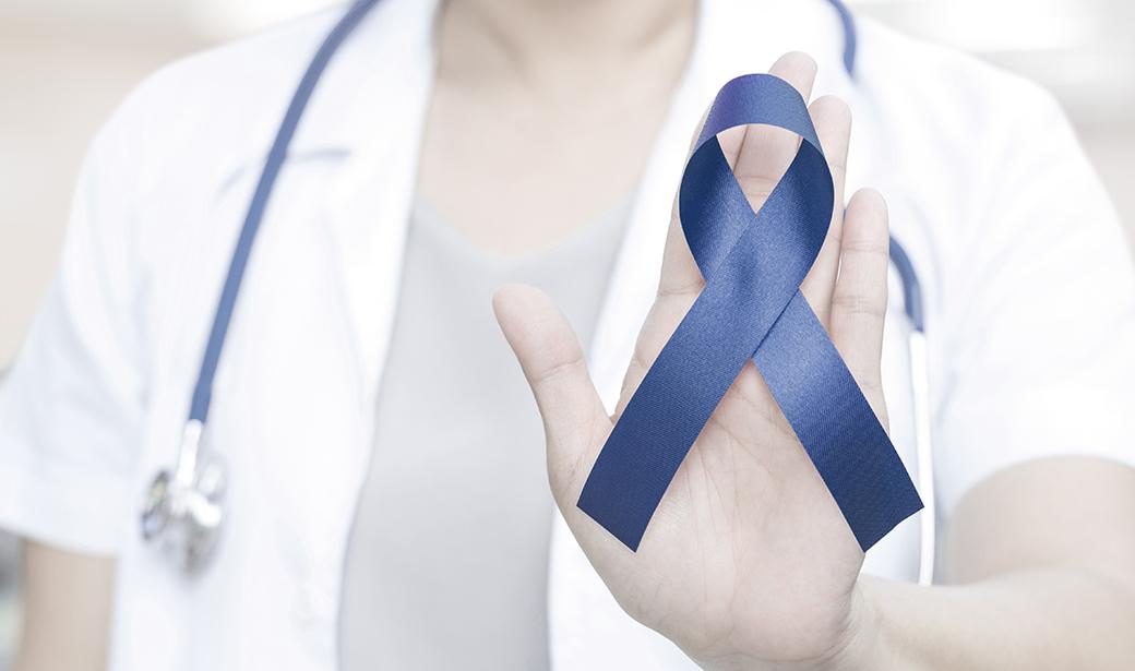 Doctor with colon cancer ribbon