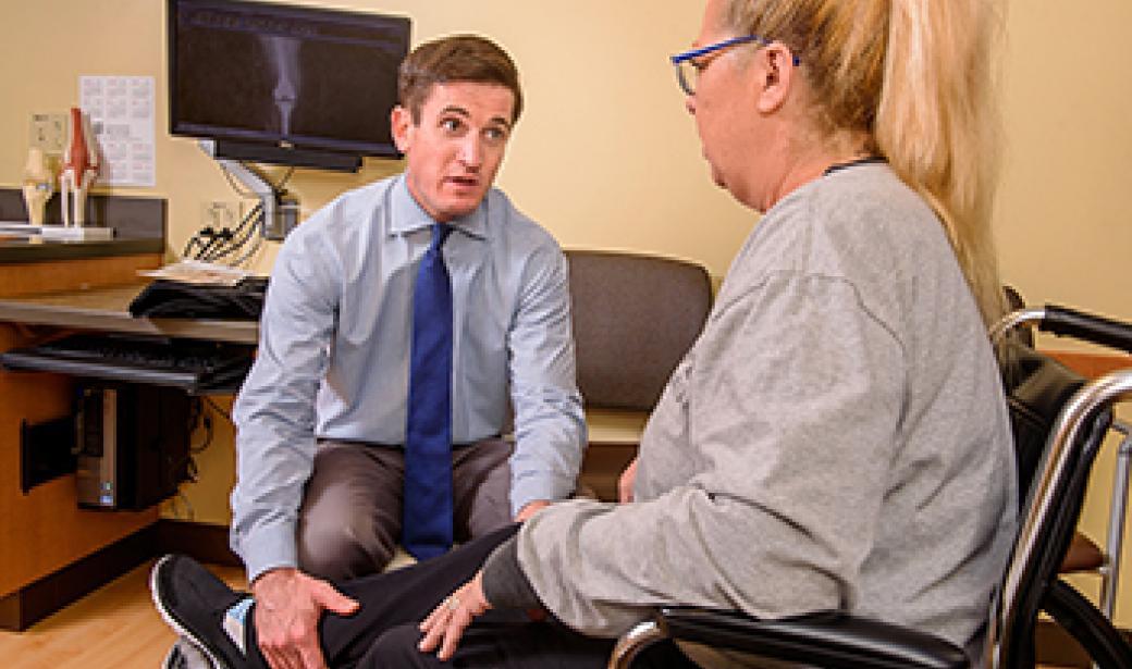 doctor with knee patient