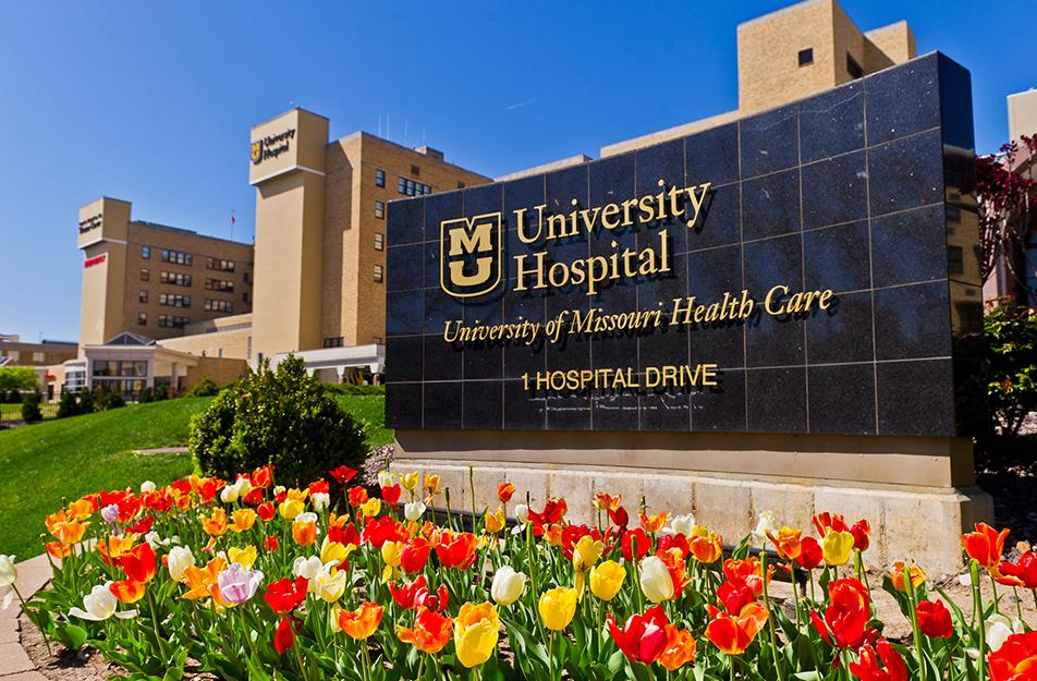Photo of University Hospital sign spring tulips