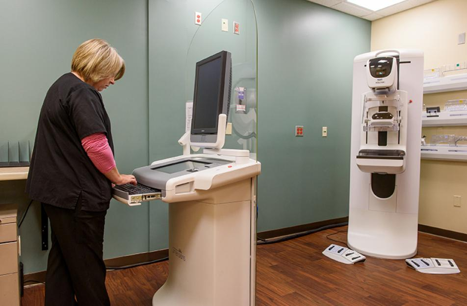 nurse testing out imaging equipment