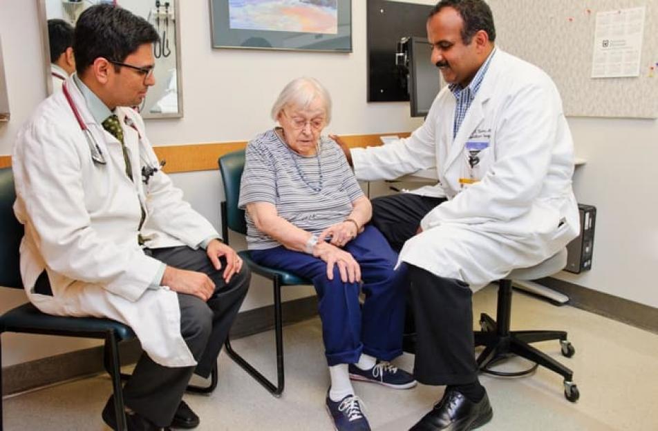 Doctors Talking To Heart Patient