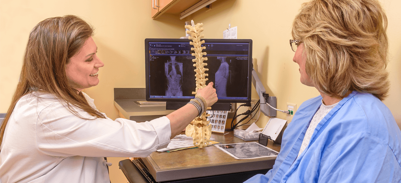 photo of spine specialist and patient
