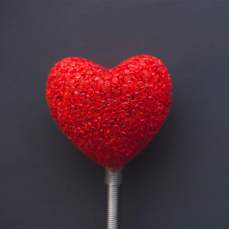 Red heart on dark background